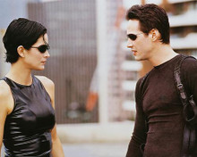This is an image of 237282 Keanu Reeves & Carrie-Ann Moss Photograph & Poster