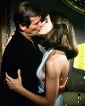 This is an image of 252508 Roger Moore & Lois Chiles Photograph & Poster