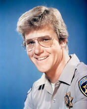 This is an image of 283813 Larry Wilcox Photograph & Poster