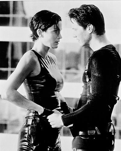 This is an image of 169834 Keanu Reeves & Carrie-Ann Moss Photograph & Poster