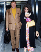 This is an image of Photograph & Poster of Elizabeth Taylor and Richard Burton 284875