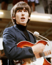 This is an image of Photograph & Poster of George Harrison 292989