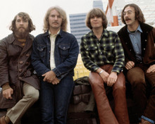 This is an image of Photograph & Poster of Creedence Clearwater Revival 297416