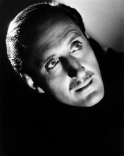 This is an image of Photograph & Poster of Basil Rathbone 197034