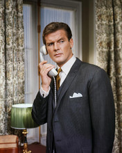 This is an image of Photograph & Poster of Roger Moore 288356