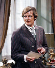 This is an image of Photograph & Poster of Roger Moore 288388