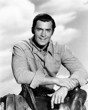 This is an image of Photograph & Poster of Clint Walker 198010