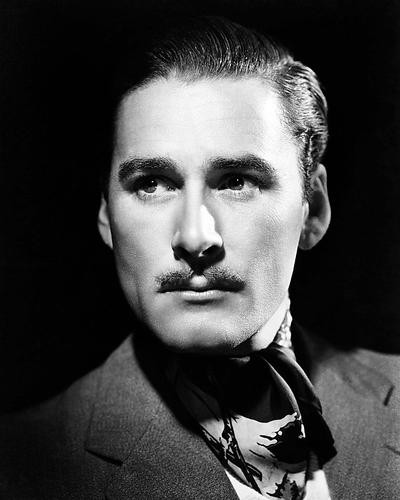 This is an image of Photograph & Poster of Errol Flynn 199468