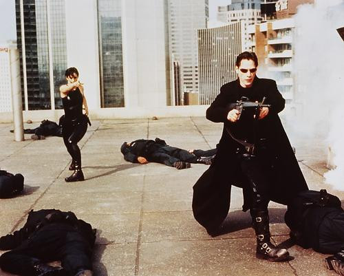 This is an image of 243083 Keanu Reeves & Carrie-Ann Moss Photograph & Poster