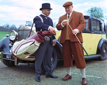 This is an image of 280898 Gert Frbe as Auric Goldfinger and Harold Sakata as Oddjob in Goldfinger