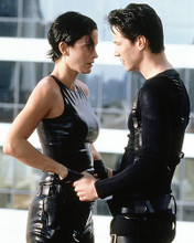 This is an image of 280927 Keanu Reeves as Neo and Carrie-Anne Moss as Trinity in The Matrix