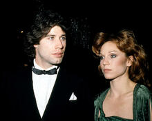 This is an image of 282810 John Travolta and Marilu Henner Photograph & Poster