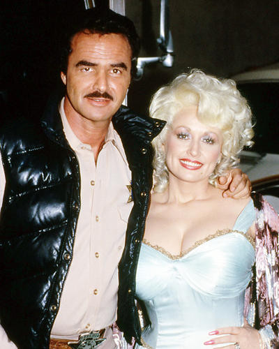 This is an image of 293468 Dolly Parton and Burt Reynolds Photograph & Poster