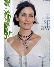 This is an image of 252855 Carrie-Anne Moss Photograph & Poster
