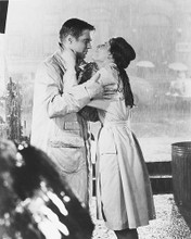 This is an image of 172683 Audrey Hepburn & George Peppard Photograph & Poster