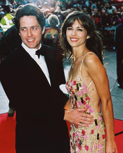 This is an image of 238840 Elizabeth Hurley & Hugh Grant Photograph & Poster
