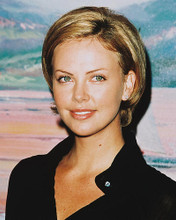 This is an image of 245325 Charlize Theron Photograph & Poster