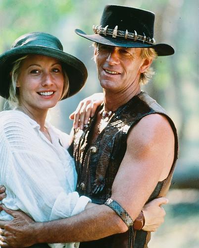 This is an image of 246939 Paul Hogan and Linda Kozlowski Photograph & Poster