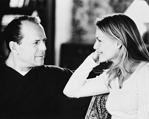 This is an image of 169852 Bruce Willis & Michelle Pfeiffer Photograph & Poster