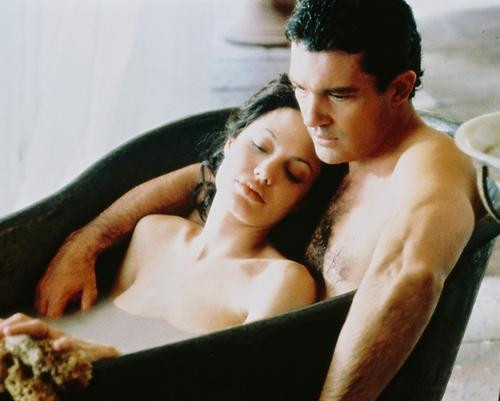 This is an image of 245940 Antonio Banderas and Angelina Jolie Photograph & Poster