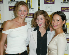This is an image of 254378 Cameron Diaz Drew Barrymore and Lucy Liu Photograph & Poster