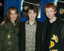 This is an image of 254642 Daniel Radcliffe, Emma Watson and Rupert Grint Photograph & Poster