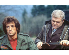 This is an image of 256067 Sylvester Stallone and Brian Dennehy Photograph & Poster