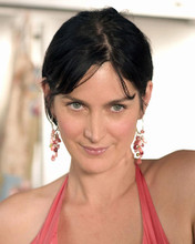 This is an image of 272567 Carrie-Anne Moss Photograph & Poster