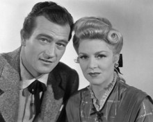 This is an image of Prints & Posters of John Wayne and Claire Trevor 105222