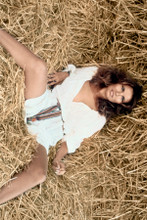 Raquel Welch sexy pose in short white dress in straw legs apart 8x12 inch photo