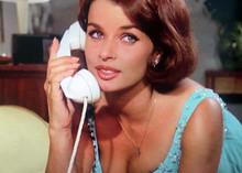 Senta Berger holding telephone wearing low cut blue dress 5x7 inch photo