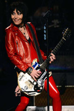Joan Jett smiling in red leather jacket and pants playing guitar 4x6 inch photo