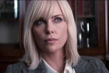 Charlize Theron in grey suit & white blouse Atomic Blonde 4x6 inch photo