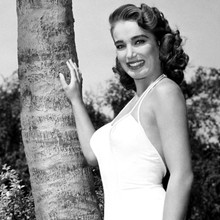 Julia Adams smiling pose in white swimsuit 12x12 inch photograph