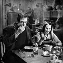 The Munsters Fred Gwynne as Herman with Lily at breakfast table 12x12 photo