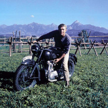 Steve McQueen on Triumph TR6 motorbike by fence The Great Escape 12x12 photo