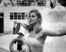 Ann-Margret in bikini by fountain 12x18  Poster