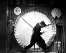 Metropolis human worker on clock 12x18  Poster