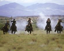 Tombstone Kurt Russell Val Kilmer and men fire rifles on horseback 12x18  Poster