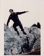 Timohty Dalton jumps from rock as Bond The Living Daylights 8x10 photo 1980's