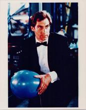Timothy Dalton as James Bond holding balloon Living Daylights 8x10 photo 1980's