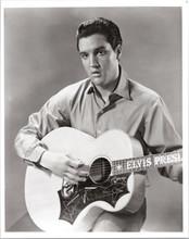 Elvis Presley rare 8x10 photograph holding his Elvis guitar
