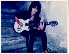 Joan Jett vintage 1970's 8x10 photo seated on steps with guitar