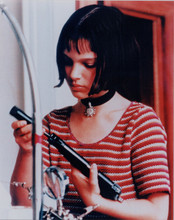 Natalie Portman putting together handgun 8x10 photo Leon The Professional