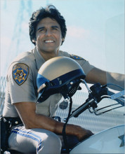 Chips 1970's TV series Erik Estrada sits astride patrol bike smiling 8x10 photo