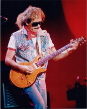 Carlos Santana in concert 8x10 photo playing guitar wearing iconic shades