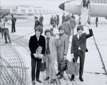 The Beatles full length posing with bags at London Airport 1965 8x10 photo