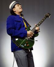 Carlos Santana cool publicity pose with his guitar 8x10 photo