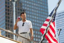 The Wolf Of Wall Street Leonardo Di Caprio on boat toasts American flag 8x10