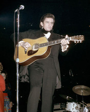 Johnny Cash 1969 in black outfit playing guitar on stage 8x10 photo